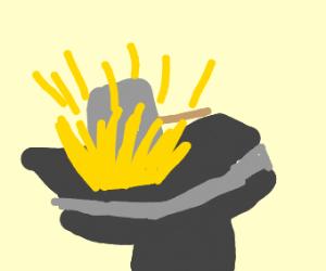 hammering an anvil