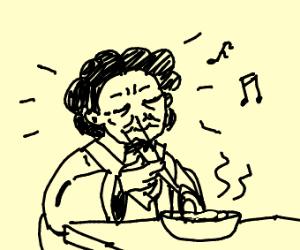Elderly Asian woman eating dinner