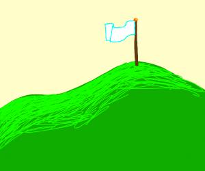 white flag on a hill