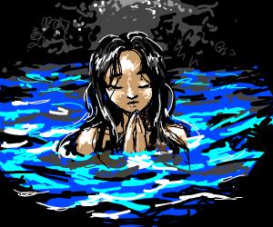 woman praying in a lake