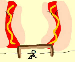 Man hiding from hotdogs under a table