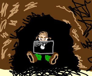 guy sitting in cave with macbook