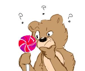teddybear is confused by lollipop