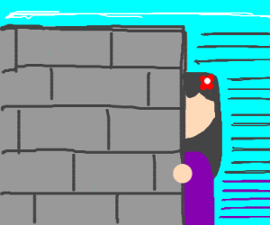 Girl standing behind a wall