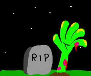 Zombie arm raising from ground