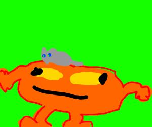 Cat on the head of an orange creature