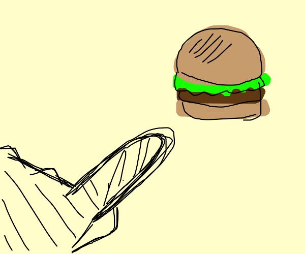 Man aggressively pointing at burger