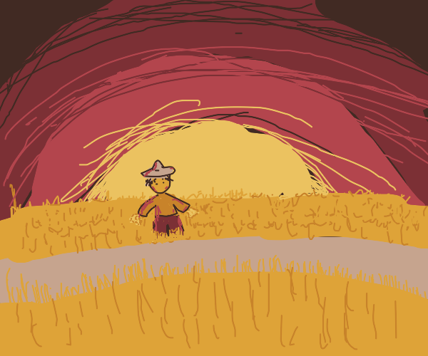 Scarecrow in a wheat field at dusk