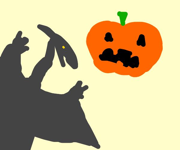 Pterodactyl flies toward a pumpkin menacingly