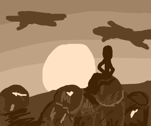 man sittin on rocks with sunset (heartbreak?)