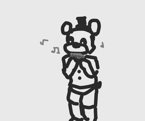 Freddy bear playing a harmonica