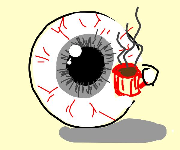 A giant eyeball drinks coffee
