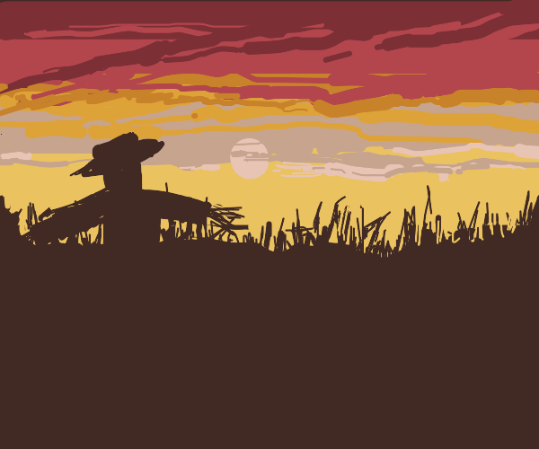 scarecrow in a cornfield w/ red sunset