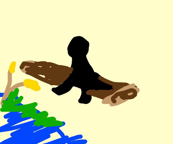 Black figure sitting on a log
