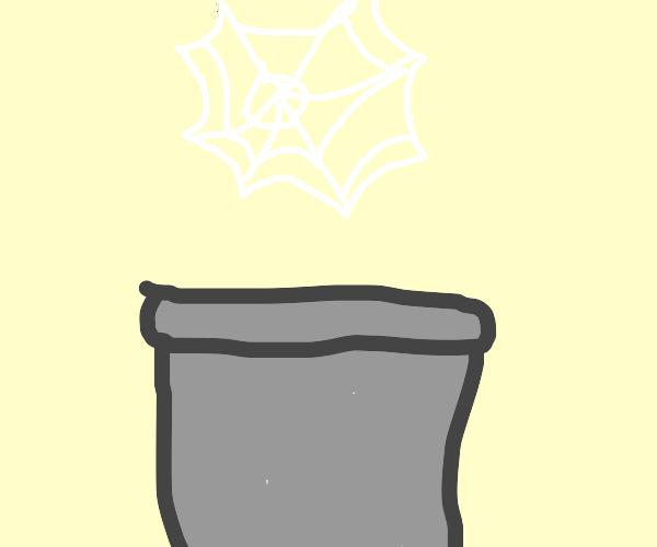 Spider web above a bucket