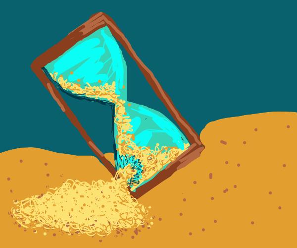 broken tilted hourglass spilling sand