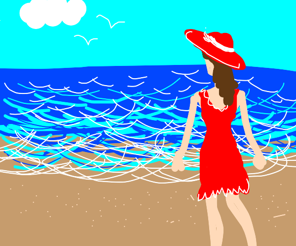 Lady in red sundress and sunhat on the beach
