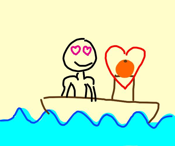 manatee admiring an orange in the ocean.