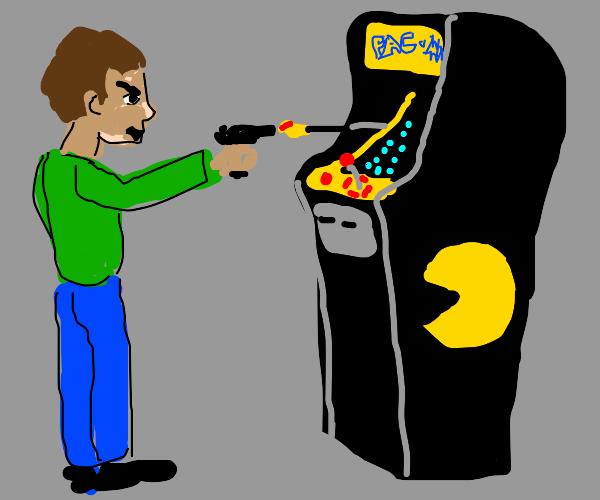 a guy shoots an arcade machine