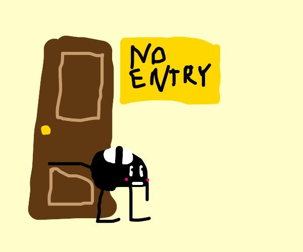 Shoes blocking a door