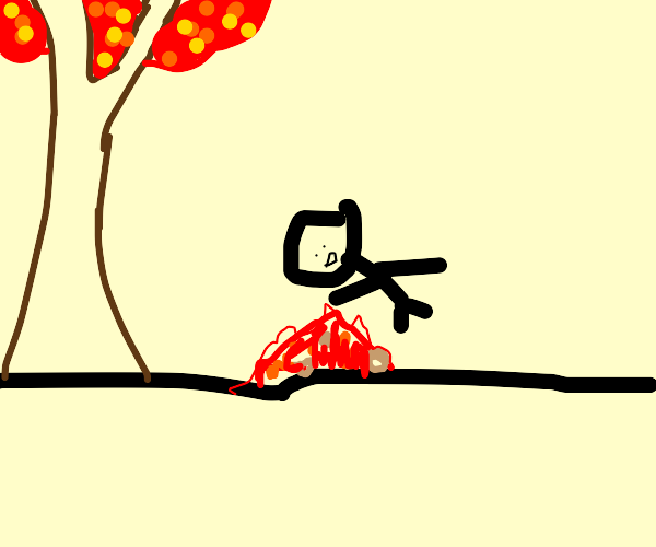 A guy falls on a pile of leafs in autum