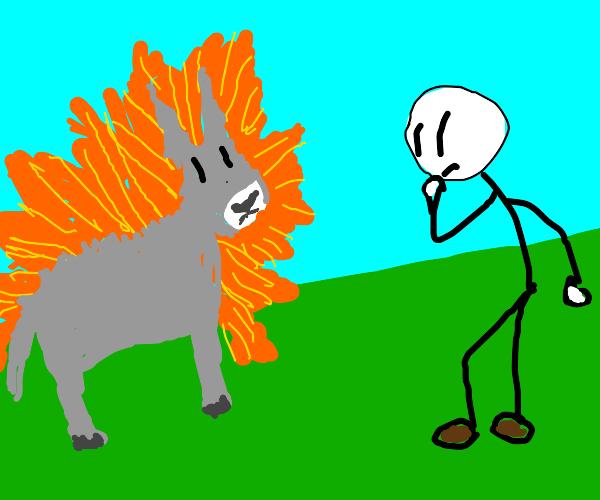 Henry Stikmen next to a flaming donkey