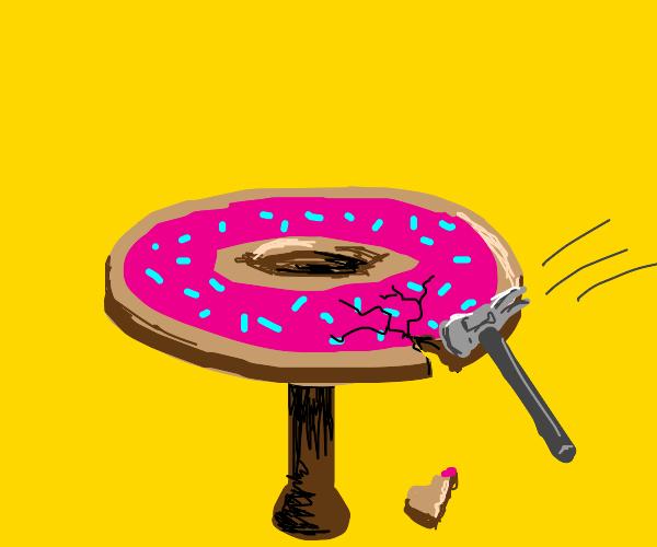 donut table breaking by hammer strike