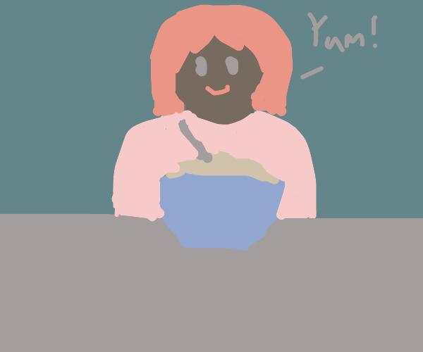 Girl happily eating oatmeal