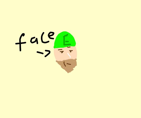 stern-faced man in green helmet