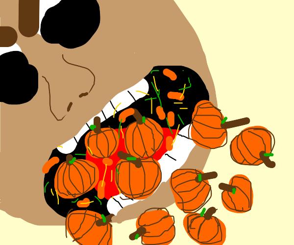 Guy eating punkins