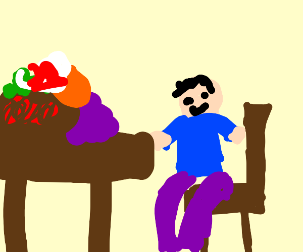 Guy sits at table with a mountain of food
