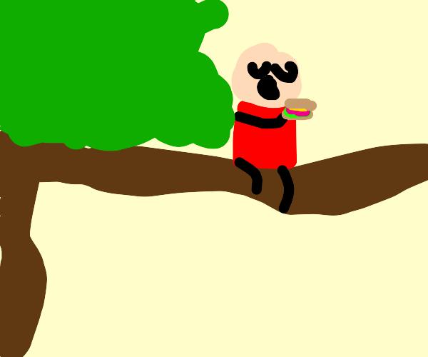 man eats sandwich on a tree branch