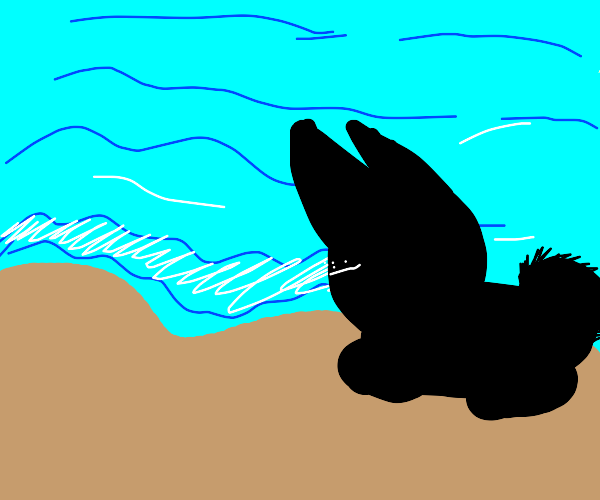 A rabbit having a picnic at the beach.