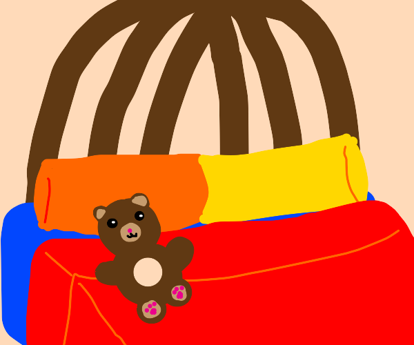 Teddy lies in bed