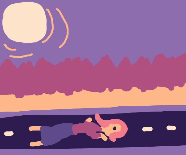 woman lying in road