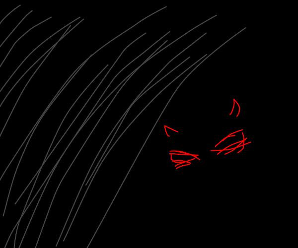Sneering demon peering out of darkness