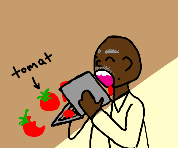 man eating tomatoes with a computer