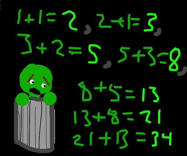 Muppet recites maths in a bin