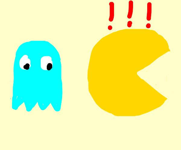 Pac-Man runs away from cyan ghost