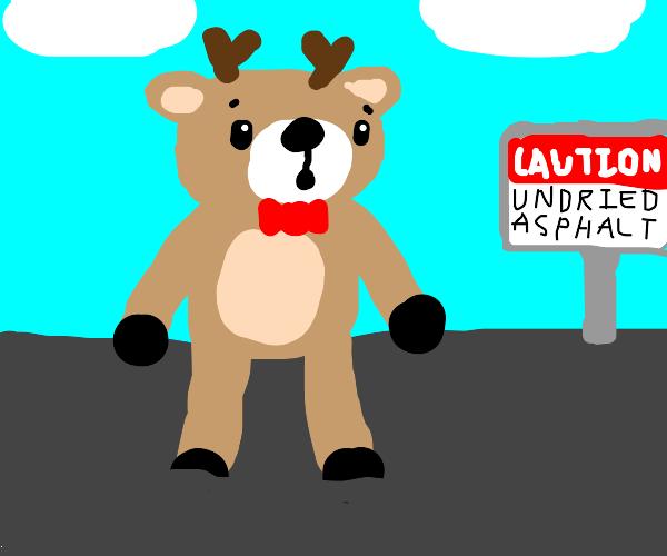 deer stuck in undried asphalt