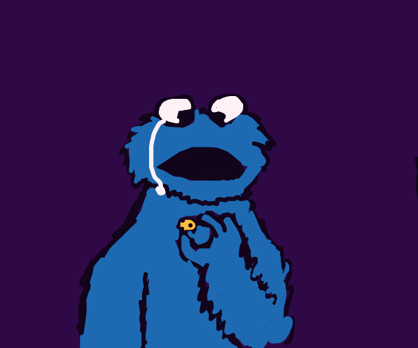 Cookie Monster sad about small cookie