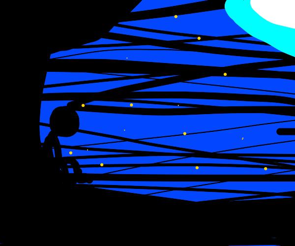 sad man near tree stargazes