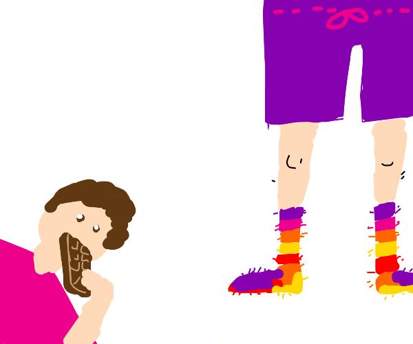 Rainbow socks man eats chocolate