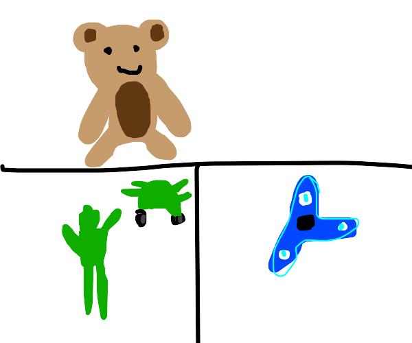 Teddy, toy soilder and blue fidget spinner