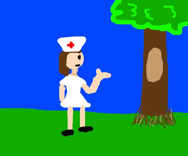 Female nurse saws a tree