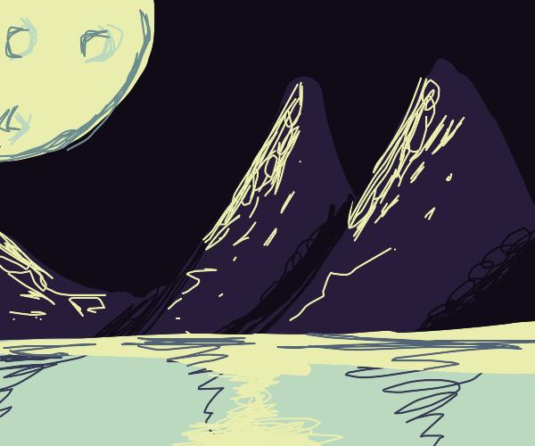 Moonlit mountains on a lake