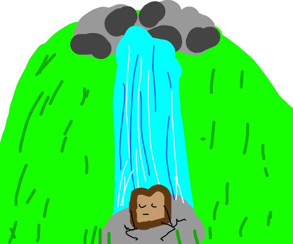 Toast meditates on rock underneath waterfall
