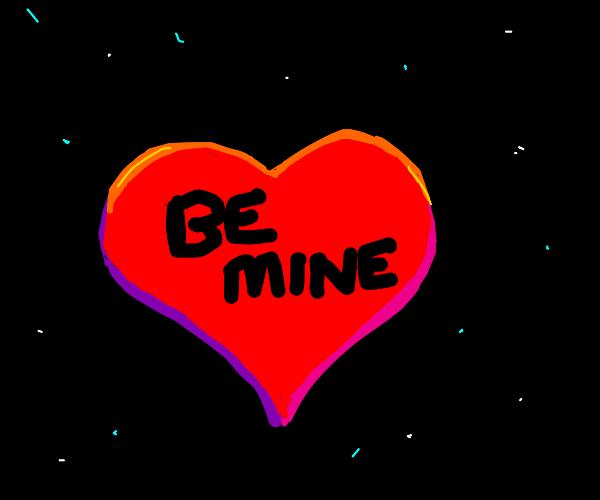 "heart with ""be mine"" written on it"