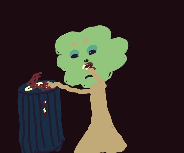 tree man sniffs garbage