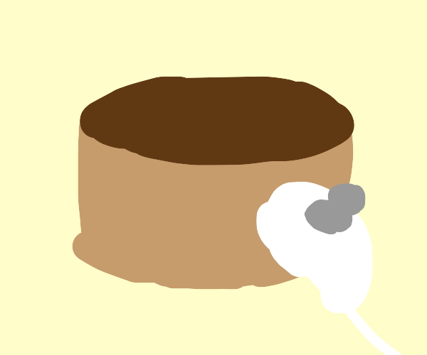 brown cake with numchucks nearbye